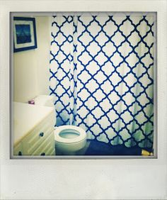 moroccan print shower curtain and framed photography