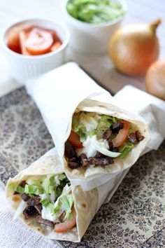 Beef Gyros is a Greek dish made out of roasted beef cooked on a vertical spit wrapped in a flat bread together with vegetables, spices and different types of sauces.