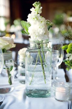 Mason jar center pieces complete the rustic elegance of this gorgeous wedding!
