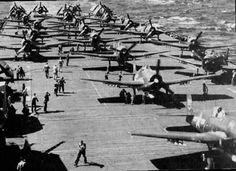 "Grumman F6F ""Hellcat"" fighters on USS Ticonderoga prepare to take off for strikes against targets in Manila Bay, Nov. 5-6, 1944."