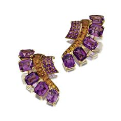 PAIR OF AMETHYST AND CITRINE QUARTZ CLIPS, FRENCH, CIRCA 1940. The scroll motifs set with 10 rectangular mixed-cut amethysts, 22 calibré-cut citrines and numerous round pavé-set amethysts, mounted in 18 karat rose gold, maker's mark and French assay marks.
