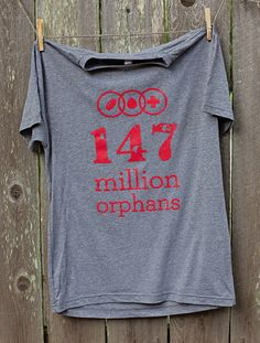 This super soft tee sports our new 147 Million Orphans logo! The Feed ! on the back of the tee tells of how your purchase of this tee goes towards feeding a child for one week. Unisex sizing for extra comfort. Heather Grey Logo Tee | 147 Million Orphans