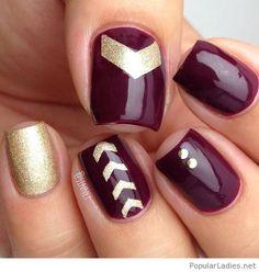 Burgundy and golden glitter nail art design