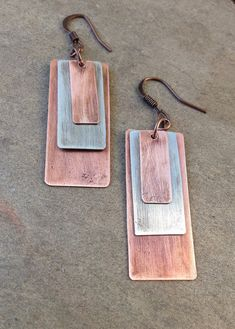 Mixed Metal Earrings / Silver and Copper by RusticaJewelry on Etsy                                                                                                                                                                                 More