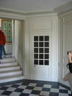 The King's guards slept & ate in this room, right under the king's apartments. These closets flanked the staircase for their personal items. Versailles private tour