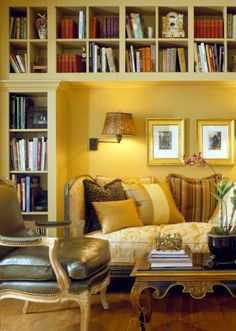 great recess for sofa. GIves presence to both the sofa and the bookcases.   Those wall mounted lamps are a must!