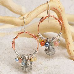 Sand Dollar Earrings.       Don't settle for just any old pair of earrings. Our Sand Dollar earrings combine Austrian crystals, amber, freshwater pearls, copper wire, and sterling plated sand dollars to create a uniquely fresh earring. Sterling ear wires.