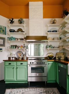 love the green cabinets and open shelving in this kitchen; Jolts of Color Restart an Old New Orleans Home love the green cabinets and open shelving in this kitchen; Jolts of Color Restart an Old New Orleans Home Green Cabinets, Kitchen Cabinets Decor, Cabinet Decor, Kitchen Backsplash, Oak Cabinets, Backsplash Ideas, Colorful Kitchen Cabinets, Bright Kitchen Colors, Refinish Cabinets