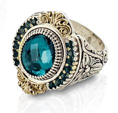 Sterling silver and 18kt gold ring which holds blue topaz and saphire gems...my babies' birthstones :)