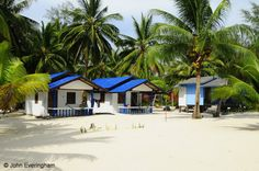 Ao Sri Thanu Beach, Koh Phangan, Thailand. Laemson 1 Bungalow has several styles of bungalow spread over a wide area with many trees.