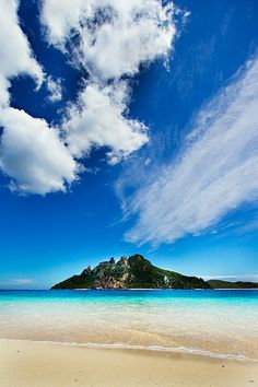 Island and clouds by Michael Leadbetter Photo, via Flickr