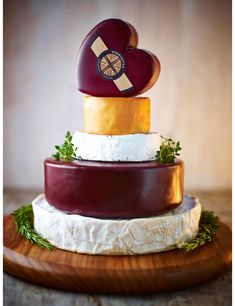 This beautiful tower of cheese wedding cake includes a range of award winning cheeses.Totalling in weight, the cheese cake contains 5 layers of organic and award winning Cheddar and Brie. Simply stunning, it would make the perfect cake alternat Cheesecake Wedding Cake, Heart Wedding Cakes, Country Wedding Cakes, Cake Tower, Wedding Cake Alternatives, Traditional Wedding Cakes, Cheese Lover, Fresh Milk, Alternative Wedding