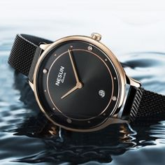 This black watch for women is a casual occasion staple styled using the ideal quality stainless steel material. The minimalistic design adds elegance to your casual look and pairs well with every style outfit. Of course, the analog display gives this women's black watch a pretty fashionable look. Wear it to check the precise time with style. #blackwatchforwomen #womensblackwatch #watcheswomenblack