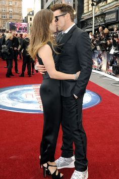 "Susan Downey and Robert Downey Jr. share a tender moment on the red carpet for ""Iron Man 3"" in Paris, France."