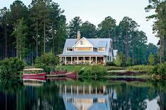 """Lake Views - Charming Home Exteriors - Southernliving. """"Iwanted to design a house that feels fresh right now but will still be relevant in…"""