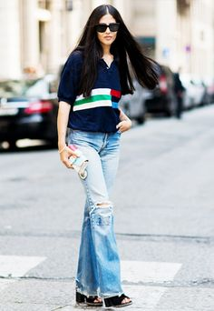 Tuck your polo into a pair of distressed flare jeans and accessorize with chunky-heel sandals.