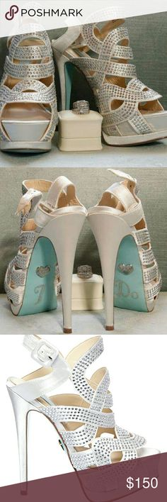 Betsey Johnson Wedding Shoes Brand new size 8 Betsey Johnson Bridal Heels never worn.. just used for bridal pic with rings because the Tiffany Blue that is on the bottom of the shoes was one of the colors of my wedding (Originally bought to wear on wedding day but bought another pair) the I DO on bottom can come off!! Paid 200 will let go for 150.00 Betsey Johnson Shoes Platforms
