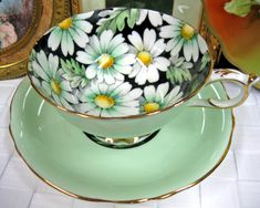 Manufacturer: PARAGON - Pattern: Daisy Chintz - Color: Green - Tea cup & saucer