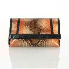Genuine copper python leather with black python detail OMBRE CLUTCH by PEcado Handbags and Accessories    python clutch   exotic leather designer clutch   designer accessories   high-end leather purse   black and orange clutch  