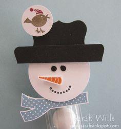 I like that this snowman uses the decorative label punch for the hat.