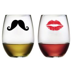 Set of 2 stemless wine glass with silkscreened images.  Product: Set of 2 stemless wine glassesConstruction Material...