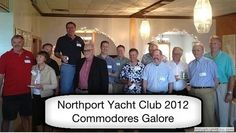 "2012-06-04 Commodores Galore, photographed at the NYC Kick-Off Celebration and submitted by Jim Kelly. ""All past Commodores of the Northport Yacht Club present, including (left to right) Gordon Fuller, Gail Witherill, Billy Haverty, Jim Kelly. Jo Huntoon, Rob Frank, Dave Witherill, Jon Linn, Art Hall, Jim Facey, Ned Lightner, Bob Witherill, and Steve Trenholm"""