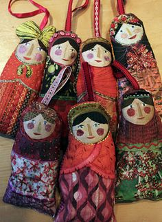 "ragtales: ""a few russian lavender (!) dolls using the spoonflower printed fabric. I have backed them with red ginghams, stuffed them with lavender and embellished them with the myriad of haberdashery that I have stashed away in various draws, I really enjoyed doing the faces..."""
