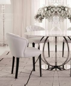 The white collection dining set. Round table topped with white marble and silver contemporary base. Iron and chrome base - love this table!