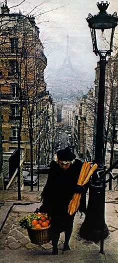 Paris, France...  Madame makes her way up stunning Paris hill, armed with baguettes and a basket of the next few days' meal ingredients.