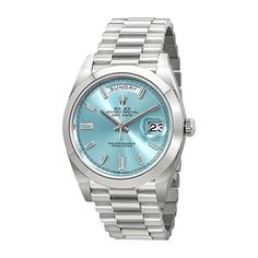 Platinum case with a platinum Rolex President bracelet. Fixed platinum bezel. Ice blue dial with silver-tone hands and baguette hour markers. Minute markers around the outer rim. Dial Type: Analog. Date display at the 3 o'clock position. Day of the week display at the 12 o'clock position. Rolex calibre 3255 automatic movement with a 70-hour …