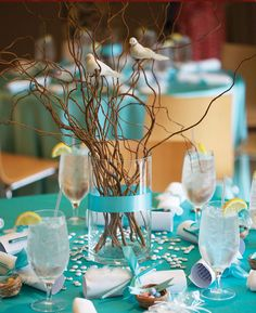 """Birds perched on curly sticks with Tiffany Blue linens.  Love this look.  """"Feathering Her Nest"""" Bridal Shower designed by Marty Weinstock held at the Zodiac Room at Neiman Marcus."""