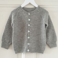 About the design:Simple and classic cardigan with raglan sleeves, worked from the bottom up. The length of sleeves and body are easily adjustable. The button bands are worked at the end. No...
