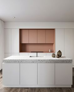 Eclectic kitchen with pink cabinets and terrazzo countertop designed by Amr Moussa
