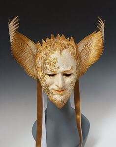 Lucifer, Heylel, light-bringer by Cyndy Salisbury of The Art of The Mask on Etsy. Materials: wool and parchment papers, crystals, ribbon, artists acrylics