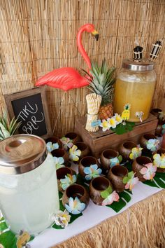 Hawaiian party drinks table - flamingo / luau...don't forget to use the beach mats we have in closet