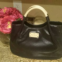 Auth Kate Spade Fulton handbag Like new condition. Only carried twice..it's medium sized...I carry the kitchen sink so this beauty isn't big enough for me. Stored in original dust bag (included). No flaws that I can see. I still have the care card in the pocket inside.  Coated black canvas with 4 little gold pegs on bottom of purse.  From smoke free home. BUNDLE MY BEAUTIES TO SAVE YOU MORE! kate spade Bags