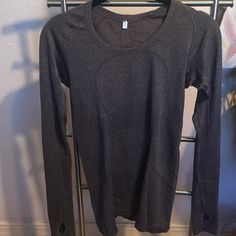 Lululemon Long Sleeve Swiftly size 6 Lululemon size 6 long sleeve swiftly. Heathered black- but it looks dark gray. In great condition, worn a few times. No snags I can see. Just don't wear swiftlies! lululemon athletica Tops Tees - Long Sleeve