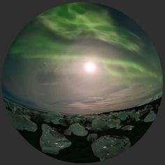 From apod.nasa.gov ~ Not from a snowglobe, this expansive fisheye view of ice and sky was captured on February 1, fromJökulsárlón Beach, southeast Iceland, planet Earth. Chunks of glacial ice on the black sand beach glisten in the light of a nearly full moon surrounded bya shining halo.