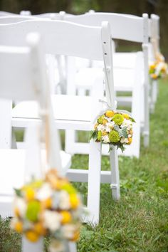 Yellow & green pomanders line the aisle of this gorgeous outdoor wedding
