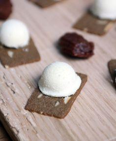 white chocolate bonbon on a Jules Destrooper almond thin by Hot Cuisine de Pierre