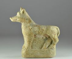 Greek terracotta statuette of a dog, 4th-1st century B.C. 8.2 cm high. Private collection
