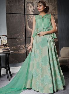Bring out the true diva in you and reinvent your true self. Style and trend will be at the peak of your beauty when you attire this sea green jacquard silk lehenga choli. This attire is beautifully adorned with embroidered work. Comes with matching choli and dupatta. (Slight variation in color, fabric & work is possible. Model images are only representative.)