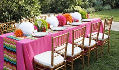 Bright pink table with colored pom poms, Vieux Paris Green Dinner Plates, Custom Multi Colored Chevron Table Runner inspired by Missoni