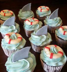 Shark & life preserver cupcakes                              …