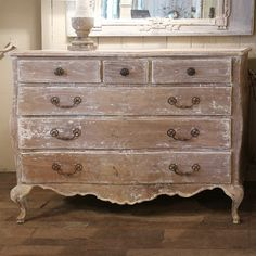 A curved chest of drawers dating from 18th-19th century