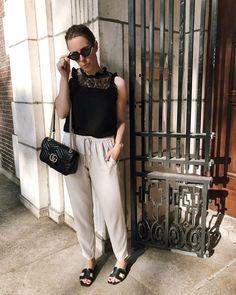 b947d207d Black top with lace detail beige flowy pants black slides sandals slippers  Hermes dupe Gucci Marmont
