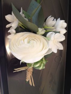 paperwhite & ranunculus buttonhole with rafia