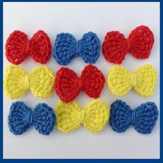 9 Small blue, red and yellow crochet bows, appliques and embellishments £2.25