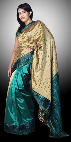 Beautiful Golden and Green colour Assam Silk Pat saree with artistic Buta work of Suta. This Saree is Known as Patli Pallu Saree. This gorgeous Collection is perfect for any festive occasion. The Saree comes with matching blouse piece, the blouse shown in the image is just for display purpose.