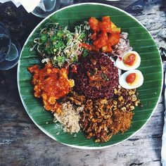 This is what I've been waiting for: Nasi Campur! A traditional Balinese mixed rice dish with many elements, like mung bean salad, roasted coconut, and eggs with sambal to name just a few. All vegetarian and organic, at The Yellow Flower Cafe. #foodoftheday #dinner #nomnomnom